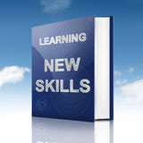 New skills concept. Illustration depicting a book with a new skills concept title. Sky background Stock Images