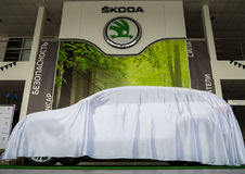 New Skoda car under the cover at the presentation of the model Stock Image
