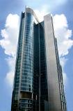 New skyscraper. Sky-scraper against blue sky and clouds Stock Photo