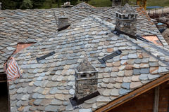 New Slate Tile Roof. Schist Roof Tiles Being Installed on a New House Royalty Free Stock Images