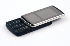 New Slider Cell Phone. A new slider cell phone. Slid open to reveal keypad Stock Photos