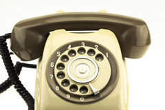 New smart phone with old telephone on white background. New communication technology.  stock photo