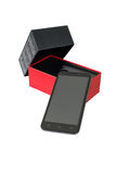 New smartphone. Modern new mobile phone in the box, isolated on a white background Stock Image