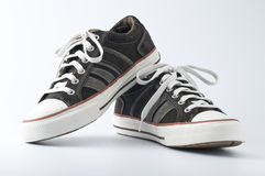 New sneakers. New trendy Converse-looking sneakers on a white background Royalty Free Stock Image