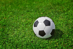 New soccer ball on green grass Stock Photo