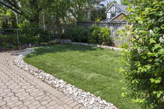 New Sod in the Garden. Backyard Garden with After Laying Down New Sod stock photo