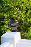 New solar lamp mounted on deck post outdoors Stock Photography