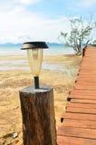 New solar lamp on wood bridge Royalty Free Stock Images