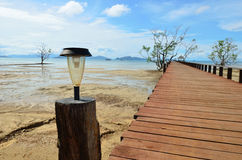 New solar lamp on wood bridge Royalty Free Stock Photography