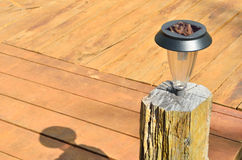 New solar lamp on wood bridge Royalty Free Stock Images