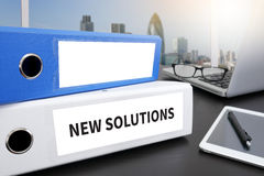 NEW SOLUTIONS. Office folder on Desktop on table with Office Supplies Stock Images