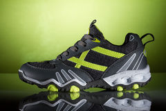 New sport shoe on a green background Stock Photography