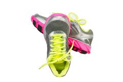 New Sports Shoes on White. New work out shoes in bright green, silver and pink colors isolated on white Stock Image