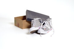 New sportsmanlike shoe with shoebox. Beautiful brand new athletic shoes for kids or child with shoebox Stock Photo