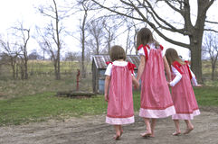 Spring sisters hand in hand Royalty Free Stock Image