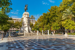 New Square or Plaza Nueva in Seville, Spain. Overview of the New Square, Plaza Nueva, with the monument to King Ferdinand III in the center, in the sunny summer Royalty Free Stock Photography