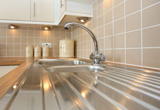 New Stainless Steel Kitchen Sink. Modern kitchen sink with mixer tap or faucet stock image