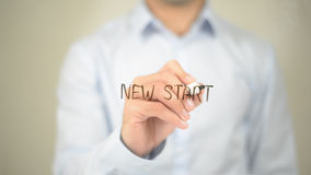 New Start , Man writing on transparent screen Stock Image