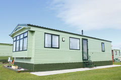New static trailer home caravan. New boxed in sited static trailer home caravan Stock Photos