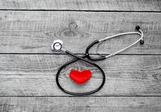New stethoscope with plush heart on wooden table isolated Stock Photography