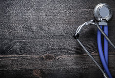 New stethoscope on vintage wooden board medicine Royalty Free Stock Image