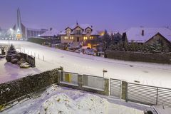 New stone fence at snowy night, Poland. Stonework house winter outdoor nobody architecture dusk twilight dark home gray concrete wall construction material stock image