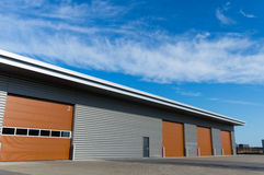 New storage warehouse with brown doors Royalty Free Stock Photo