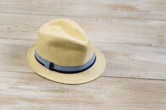 New Straw Hat on Faded Wood Royalty Free Stock Image
