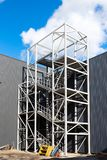 New street metal staircase. Fire escape at a modern industrial building on a sunny day royalty free stock photography