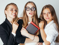 New student bookwarm in glasses against casual group on white, teen drama, lifestyle people concept Royalty Free Stock Photos
