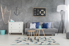New style grey room with nautical decorations. Sofa and floor lamp stock photos