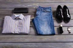New stylish men's clothing. New stylish men's clothing on store shelf Stock Images