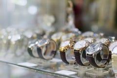 New stylish modern wristwatch in glass showcase Stock Photography