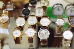 New stylish modern wristwatches in glass showcase Stock Photography