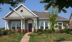 New suburban house. With garden in friendly community royalty free stock images