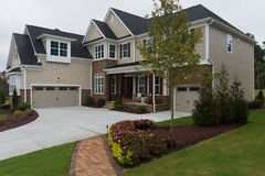 New suburban house. Newly constructed suburban house for sale Stock Photos