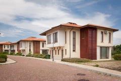 New suburban houses. Perfect neighborhood. Blue sky Royalty Free Stock Photo