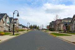 New Suburban Neighborhood Street in North America. New North American suburban upscale neighborhood homes along street in Happy Valley Oregon United States royalty free stock image