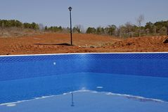 New Swimming Pool Liner. Liner installed in new swimming pool construction royalty free stock photos