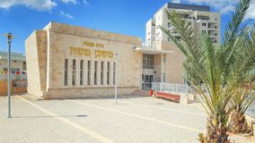 New synagogue in living neighborhood in Israel. Ness Ziona, Israel-March 11, 2018: A newly build synagogue a tall one-story building with a prayer room and an stock photo