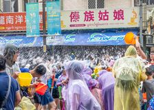 Unidentified people in water fight for Songkran Festival stock images