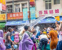 Unidentified people in water fight for Songkran Festival stock photography