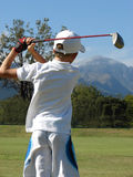 New Talent. Young golfer following his ball after a shot with a driver on the golf course Royalty Free Stock Image