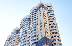 New tall apartment building against blue sky background Royalty Free Stock Image