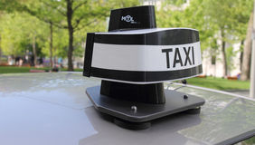 New taxi dome. The new dome design found on the top of cabs in Montreal, now all taxi companies must equip their fleet with them stock images