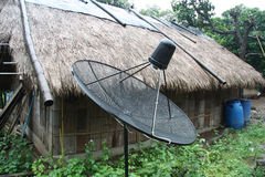 New technologies. In the old world, satellite dish in a thai village Royalty Free Stock Photos