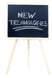 New technologies. A chalkboard on white with new technologies written on it Royalty Free Stock Photo