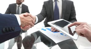 New technologies and business partnership. Handshake business colleagues in office stock photos