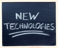 New Technologies Closeup. A chalkboard with the word New technologies written on it Royalty Free Stock Images
