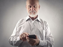 New technologies. Elderly man using new technologies to communicate Stock Images